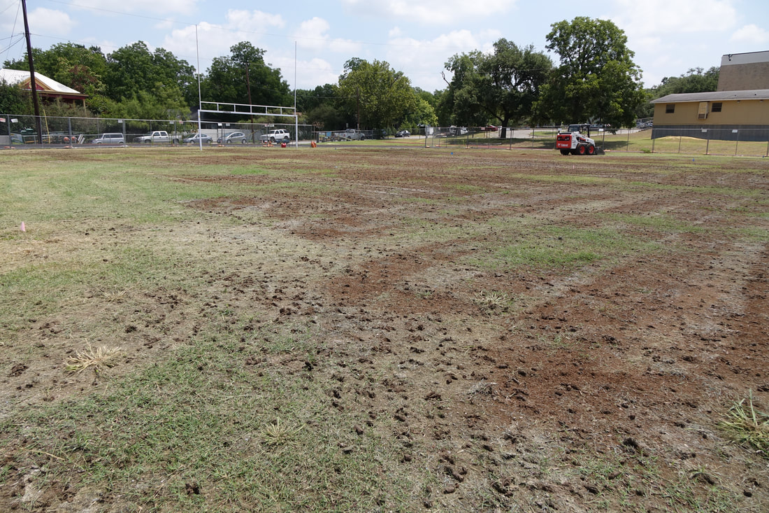 Aeration service on a football field in Austin